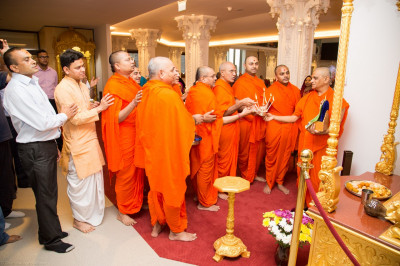 His Divine Holiness Acharya Swamishree, sants and disciples perform aarti to Shree Hanumanji