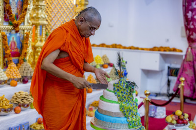 His Divine Holiness Acharya Swamishree cuts the peacock themed cake