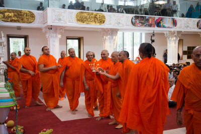 His Divine Holiness Acharya Swamishree and sants performs aarti after the magnificent annakut is revealed