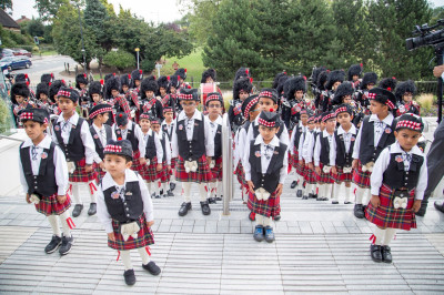 Shree Muktajeevan Pipe Band London cadets and members await to escort His Divine Holiness Acharya Swamishree to the flag ceremony