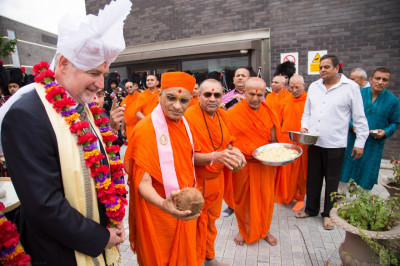 His Divine Holiness Acharya Swamishree performs the coconut breaking ceremony