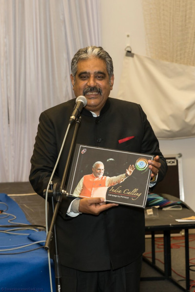 The honoured guest is the publisher of a book that depicts the travels of the Prime Minister of India