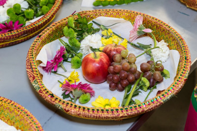 Disciples prepare swagat plates with fruit, nuts, flowers and various gifts