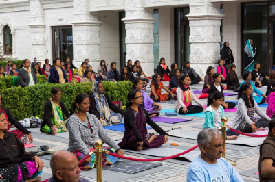 Hundreds of disciples perform yoga celerating the first international world yoga day within the peaceful setting of Shree Muktajeevan Swamibapa Complex