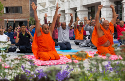 His Divine Holiness Acharya Swamishree, sants and hundreds of disciples perform yoga celerating the first international world yoga day within the peaceful setting of Shree Muktajeevan Swamibapa Complex