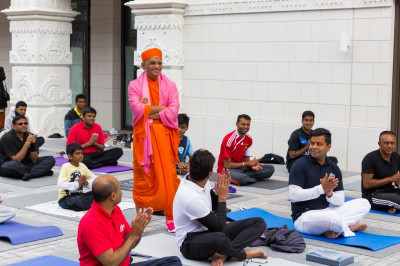 His Divine Holiness Acharya Swamishree blesses all disciples who took part in the yoga session