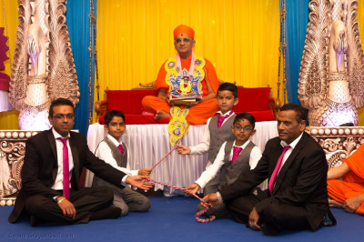 Disciples get an opportunity to swing Acharya Swamishree Maharaj on a swing