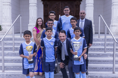 The Swamibapa FC team dressed in their new colours with the sponsors outside Shree Swaminarayan Mandir Kingsbury