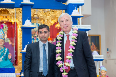 Dr. Mahesh Varsani - trustee of Shree Swaminarayan Mandir Kingsbury with Rt Hon Earl Howe - Minister of State for the Ministry of Defence