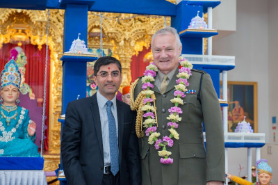 Dr. Mahesh Varsani - trustee of Shree Swaminarayan Mandir Kingsbury garlands General Gordon Messenger (Vice Chief of the Defence Staff)
