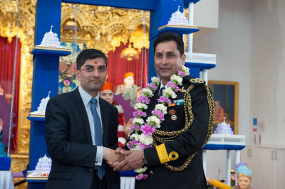 Dr. Mahesh Varsani - trustee of Shree Swaminarayan Mandir Kingsbury garlands Commodore Sameer Saxena (Naval advisor to the Indian High Commission)