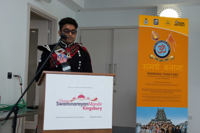 A member of Shree Muktajeevan Swamibapa Pipe Band London addresses all gathered