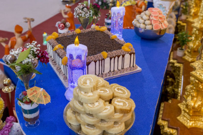 Various cakes and desserts are offered to the Lord