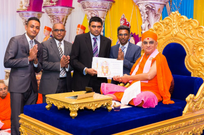 His Divine Holiness Acharaya Swamishree blesses all of the certificates to be presented