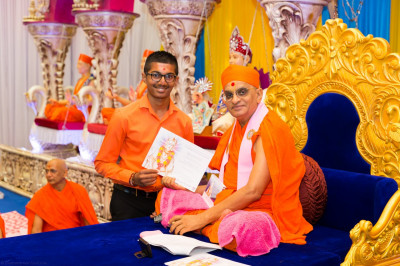 His Divine Holiness Acharya Swamishree blesses disciples who have attained passes in their GCSE examinations