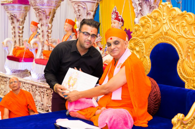 His Divine Holiness Acharya Swamishree blesses disciples who have attained passes in their A-level examinations