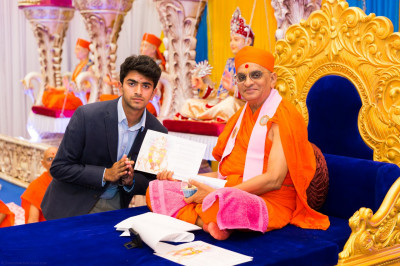 His Divine Holiness Acharya Swamishree blesses disciples who have attained very high grades in their GCSE examinations