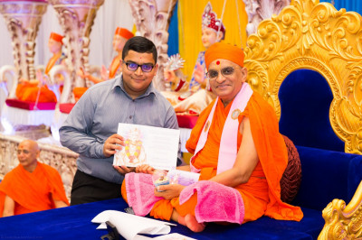 His Divine Holiness Acharya Swamishree blesses disciples who have attained very high grades in their A-level examinations