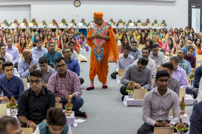 His Divine Holiness Acharya Swamishree blesses all during the mahapooja
