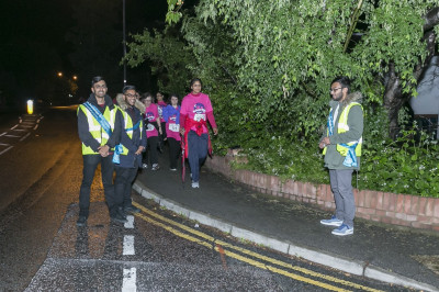 Volunteers are distributed throughout the 9 mile route