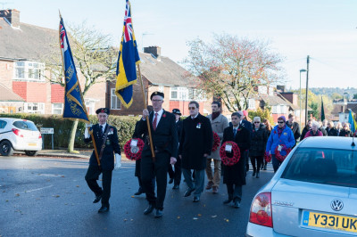 Various local councillors and dignatories march the route from the local  British Legion headquarters to the Edgware remembrance day memorial