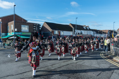 Shree Muktajeevan Swamibapa Pipe Band perform leading the procession back to the New Edgware Royal British Legion Headquarters