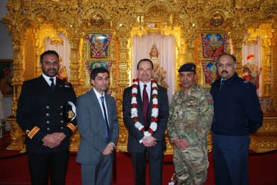 Hindu Service personnel accompany the Admiral Surg Lt Cdr Manish Tayal (Royal Navy), WO1 Ashok Chauhan (Army) and Sgt Shiv Chand (RAF)