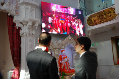 Aspects of the grand mandir and wider complex opening festival is shown to RAdm Mackay