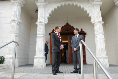 RAdm Mackay at the entrance of Shree Swaminarayan Mandir Kingsbury