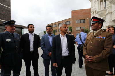 Mayor of London Sadiq Khan in mandir courtyard with other guests