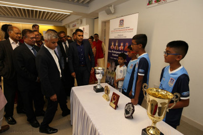 The Mayor views trophies won by participants