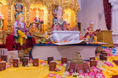 The Shikshapatri is displayed in front of Lord Shree Swaminarayan