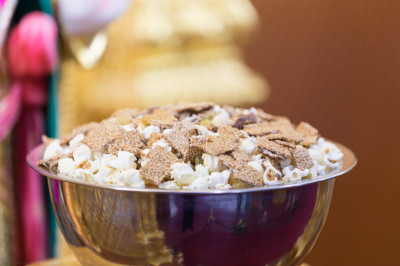 Popcorn and delicious sesame snaps are offered to Lord Shree Swaminarayanbapa Swamibapa