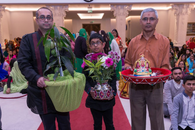 A mango tree and various gifts are offered to Lord Shree Swaminarayanbapa Swamibapa