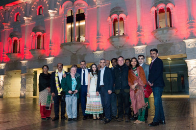 All honoured guests outside Shree Swaminarayan Mandir beautifully lit in red