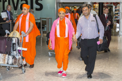 His Divine Holiness Acharya Swamishree arrives at London's Heathrow Airport
