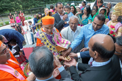 Disciples perform poojan at the entrance of Shree Swaminarayan Mandir Kingsbury