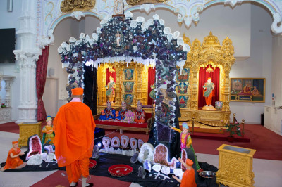His Divine Holiness Acharya Swamishree gently swings Lord Shree Swaminarayanbapa Swamibapa seated on the hindola