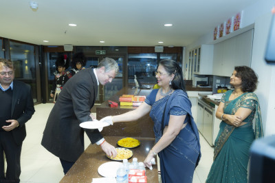 Zac Goldsmith samples some of the Indian sweets and savouries