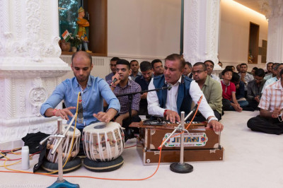 Disciples perform traditional Indian instruments during dhoon