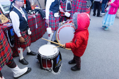 Young visitors try out the instruments of Shree Muktajeevan Swamibapa Pipe Band