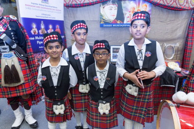 Cadets of Shree Muktajeevan Swamibapa Pipe Band London dressed in uniform guide visitors at the stall