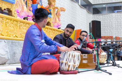 Disicples perform a tabla ensemble accompanied by Harmonium