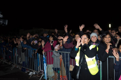 Hundreds of people gather to watch the fireworks display safely