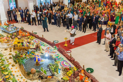 The Maharaj of Shree Swaminarayan Mandir Kingsbury performs aarti to Lord Shree Swaminarayanbapa Swamibapa