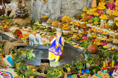 The magnificent annakut of sweet and savoury items includes a water feature in the form of a lake