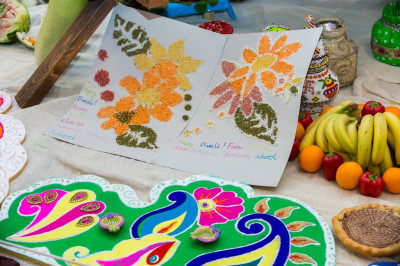 Children from a local primary school present rangoli patterns they created in class