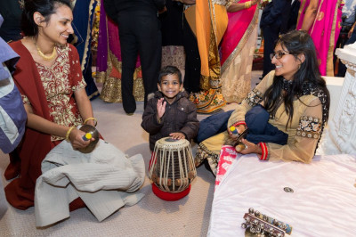 Visitors get the opportunity to try out playing traditional Indian insturments