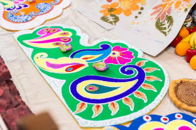 Traditional colourful rangoli patterns are created and displayed as part of the annakut decorations