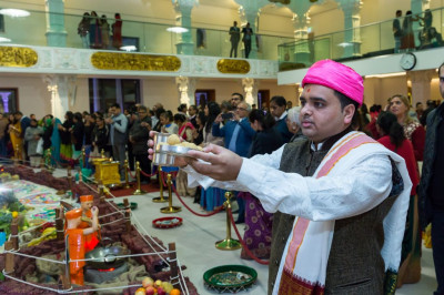 The Maharaj of Shree Swaminarayan Mandir Kingsbury offers evening thaar to the Lord